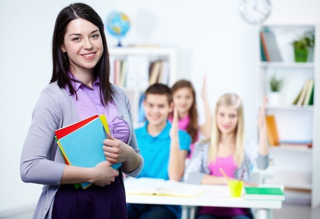 happy-teacher-with-students-background_1098-2917 Home
